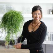 Beautiful woman with nice Rhipsalis indoor plant.